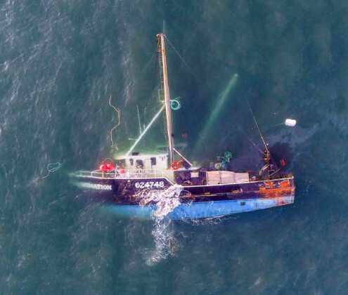 3 fishermen rescued after boat capsizes off Cape Cod coast