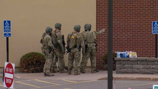 Authorities on scene of a hostage situation in St. Cloud, Minnesota, on Thursday, May 6, 2021.