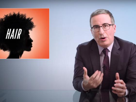 John Oliver enlists Uzo Aduba, Leslie Jones, and Craig Robinson to help explain Black hair issues