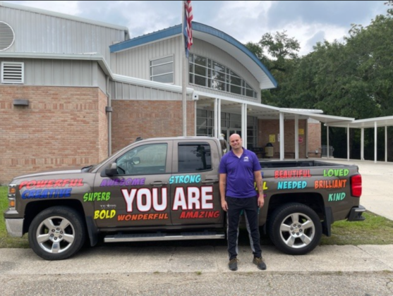 Middle school teacher decorates truck with positive affirmations, encourages students to be kind