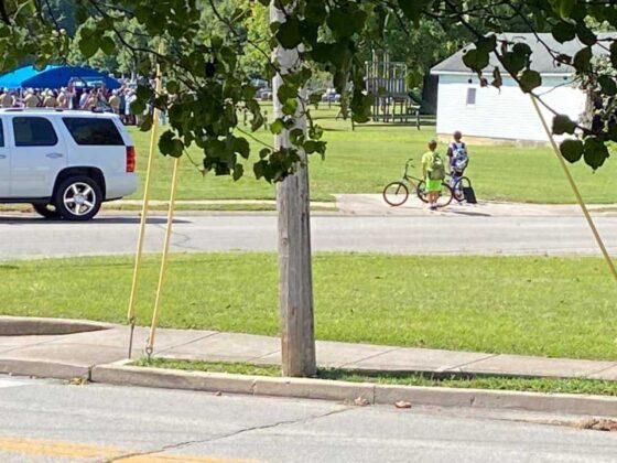 2 Indiana boys hop off bikes, pay their respects while coming across funeral for serviceman