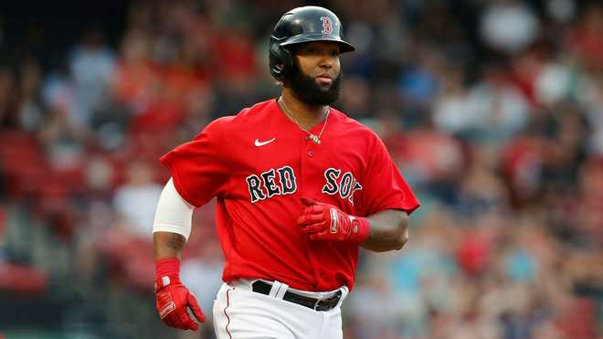 Boston Red Sox's Danny Santana plays against the Houston Astros during the first inning of a baseball game, Wednesday, June 9, 2021, in Boston. (AP Photo)