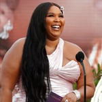 Lizzo Faces Backlash for Posing With Chris Brown & Calling Him Her 'Favorite Person'