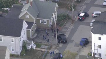 Standoff ends with suspect dead after police officer shot, injured